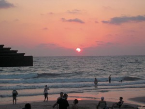 "On the beach in Haifa with dozens of others at sunset, we can only say: ""Lechayim."""