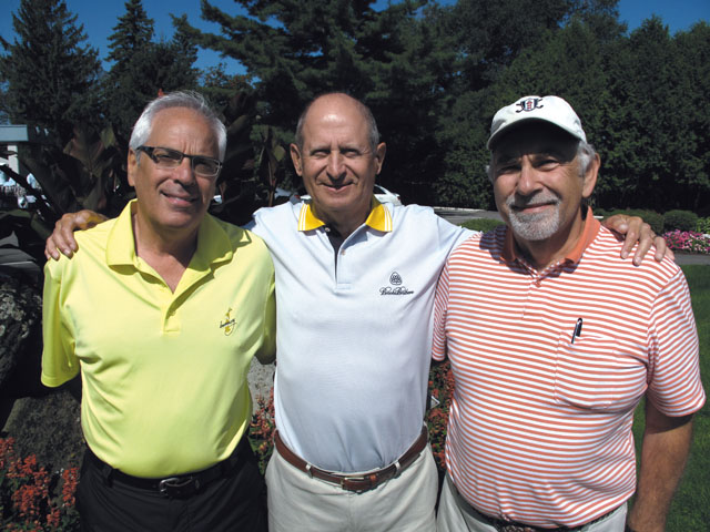 Golf tournament founding members Marvin Pascal (from left) and Lewis Israel with Mordy Gordon in 2010.  Photo courtesy of Sun Youth