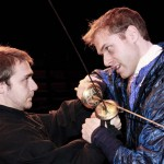 Hamlet (Christopher Moore) and Laertes (Lucas Chartier-Dessert) cross swords in Persephone Productions&#039; Hamlet.