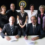 Signing the agreement last month were Sun Youths TommyKulczyk and CJM-IUs Jean-Marc Potvin. Witnessing the signing were Sylvain Dupr (from left), Isa Iasenza, Ann St. Arnaud, StphanieRocheleau and SuzanneLepage.