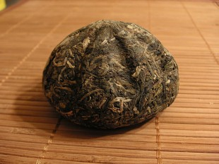 """Tea cakes"" called Pu-erh are aged, and like wine—they can be aged for 100 years. (Photo by Jason Fasi)"