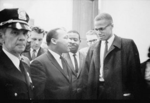 Martin Luther King (centre) and Malcolm X in 1964. (Photo by Marion S. Trikosko)