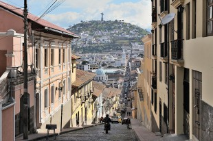Quito, capital of Ecuador, García Moreno street in the historic centre of the city. The Virgin of Quito is seen in the background. Photo by Cayambe, Wikimedia Commons