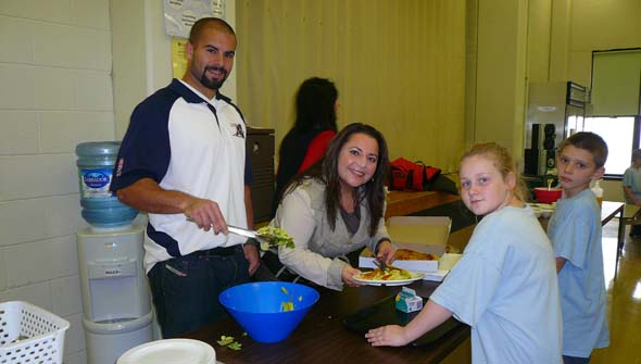 Enrica Uva and Shea Emery cook up a storm at St. Gabriel School. (Photo courtesy of Generations Foundation)