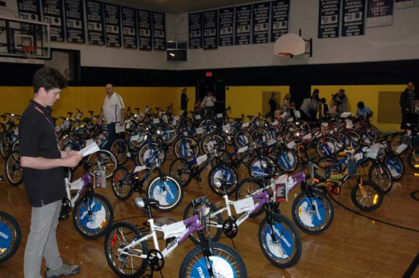 Sun Youth's Eric Kingsley making sure everything is in order before last year's New Bike Giveaway at Sun Youth, where 71 deserving children were honoured. (Photo: Nicolas Carpentier)