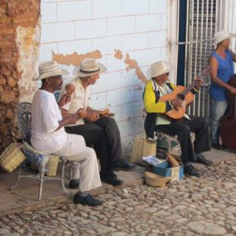 """Son"" musicians play on a cobblestone sidewalk in the town of Trinidad. (Photo by Mark Medicoff)"