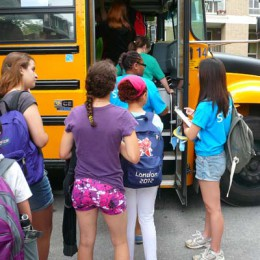 Children line up to board the bus to summer camp in the Laurentians last month. (Photo courtesy of Generations Foundation)