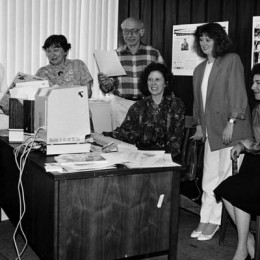 Senior Times staffers gather around their giant computer deep in the 1980s.