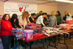 Natalie Bercovici (far left) and volunteers prepare gifts for needy children. (Photo courtesy of Generations Foundation)