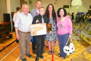 Adrian and Natalie flank St. Gabriel student Ryan Berry and his parents.