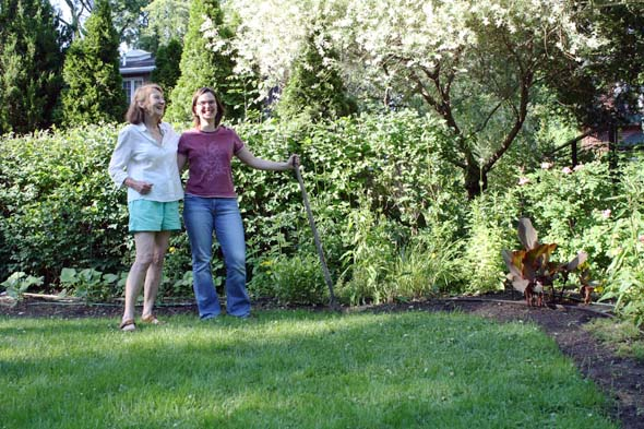 Allison Bale and Nancy Philippas work as a team in Philippas' backyard garden