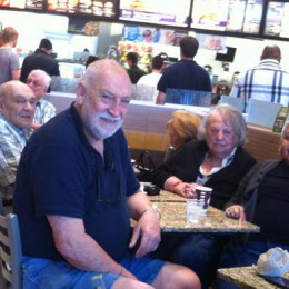Bonnie Sandler's mom, centred in the far row, enjoys breakfast at McDonald's with her gang