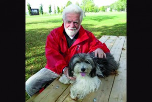 Montreal Gazette editorial cartoonist Terry (Aislin) Mosher with Sparky. (Photo by Barbara Moser)