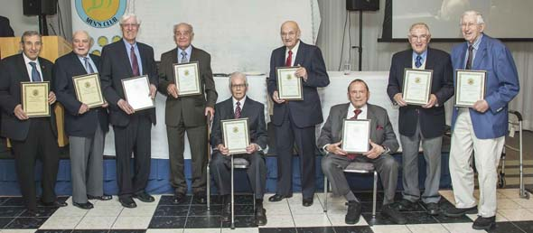 From left, receiving certificates of congratulations upon being 90: Steven Hopman, Michael Lansky, Aubrey Smofsky, Benny Bosker, Alan Sonny Rubin, Ben Abugov, Herby Paperman, Solomon Susser, Sydney Strulovitch; not shown is Frank Lemco.