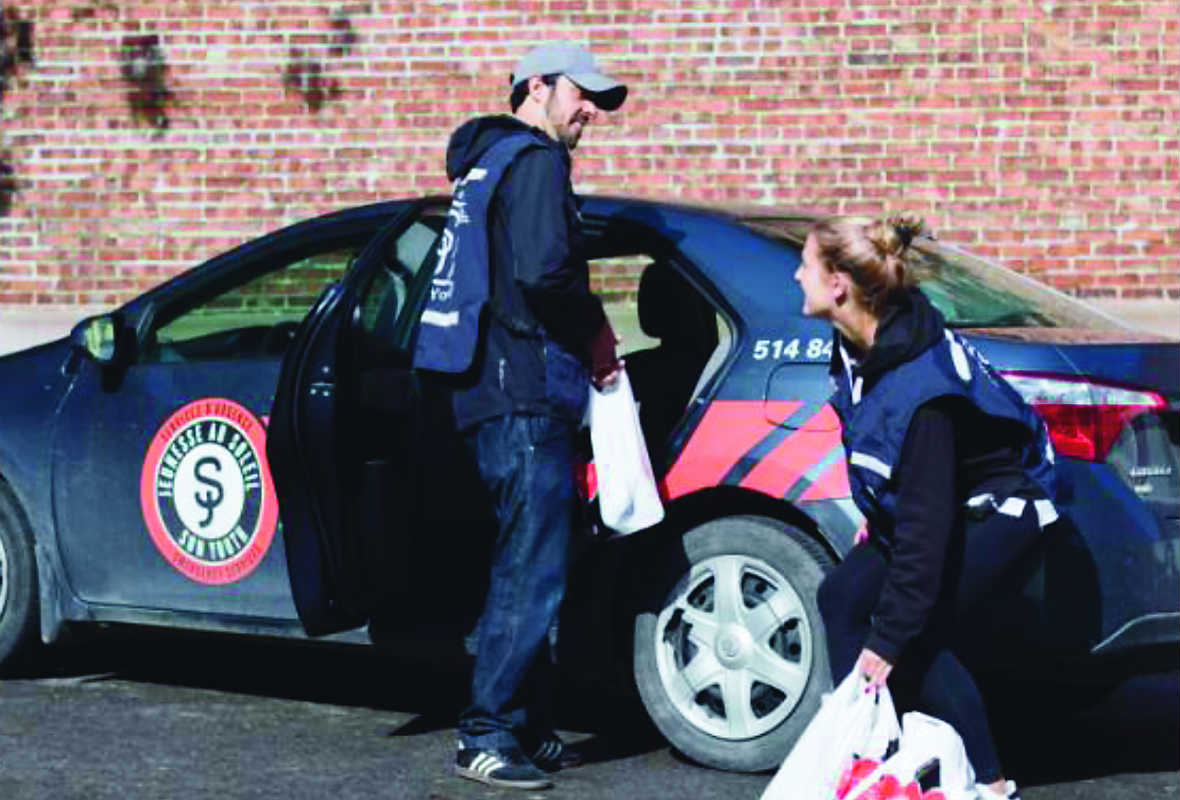 Tzach Alon and Rebecca Raaber load a Sun Youth car for our home delivery program helping those coping with isolation. Photo courtesy of Sun Youth