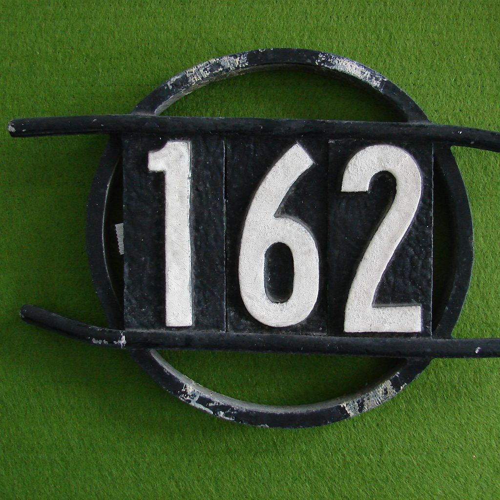 House address number. Photo by Abbey Hendrickson, via Wikimedia Commons